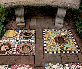 Other mosaics are built into the walkways.